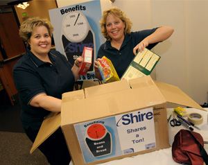 Kari Bothwell, Technical Trainer, and Pam Johnston, Sr. SQ Training Coordinator, help out with a food drive at camp.