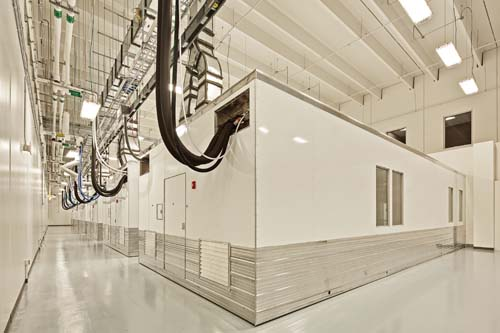 Self-contained and autonomous, each POD cleanroom houses a particular process at the DARPA facility.